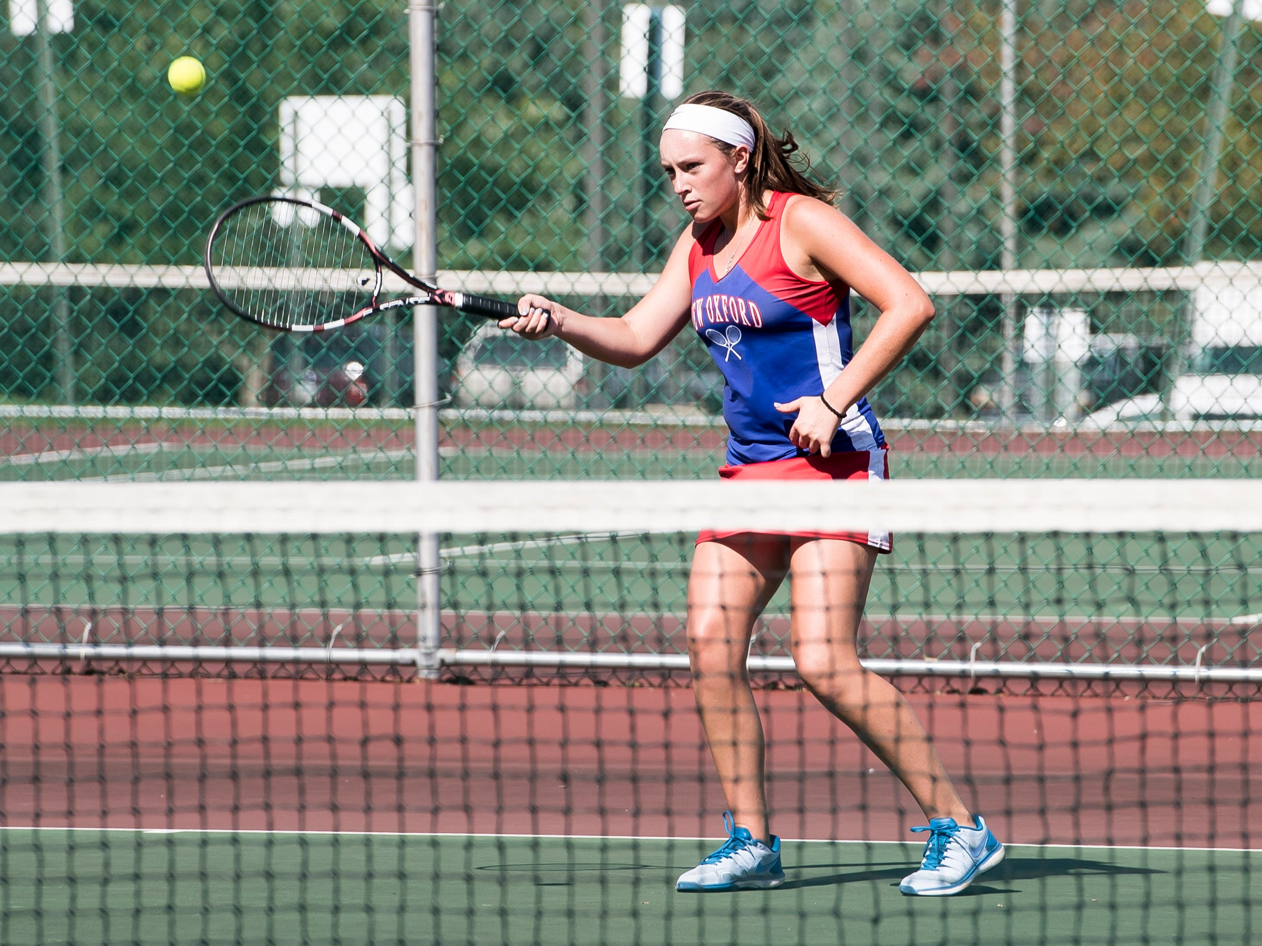 New Oxford's Kasi Conjack prepares to hit the ball to Susquehannocks Emily Ditt during the first round of the YAIAA 3A singles tournament on October 4, 2018. Conjack won 6-1, 6-2.