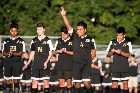 Biglerville's Christian Morales waves as he is introduced prior to a game against Delone Catholic on Wednesday, October 3, 2018.