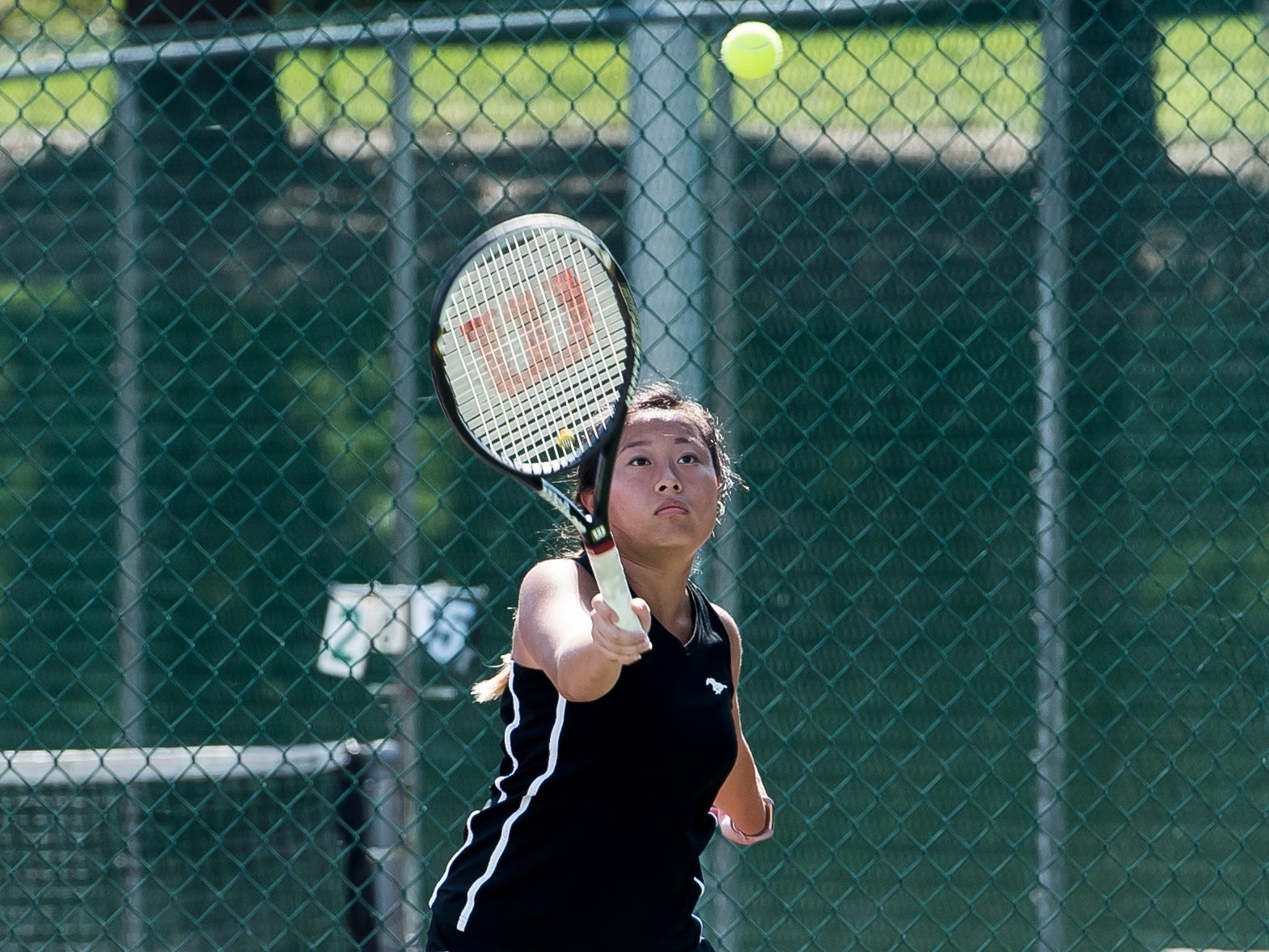 South Western's Karen Yang returns the ball to Red Lion's Zamirah Morten during the first round of the YAIAA 3A singles tournament on October 4, 2018. Yang won 6-1, 6-0.