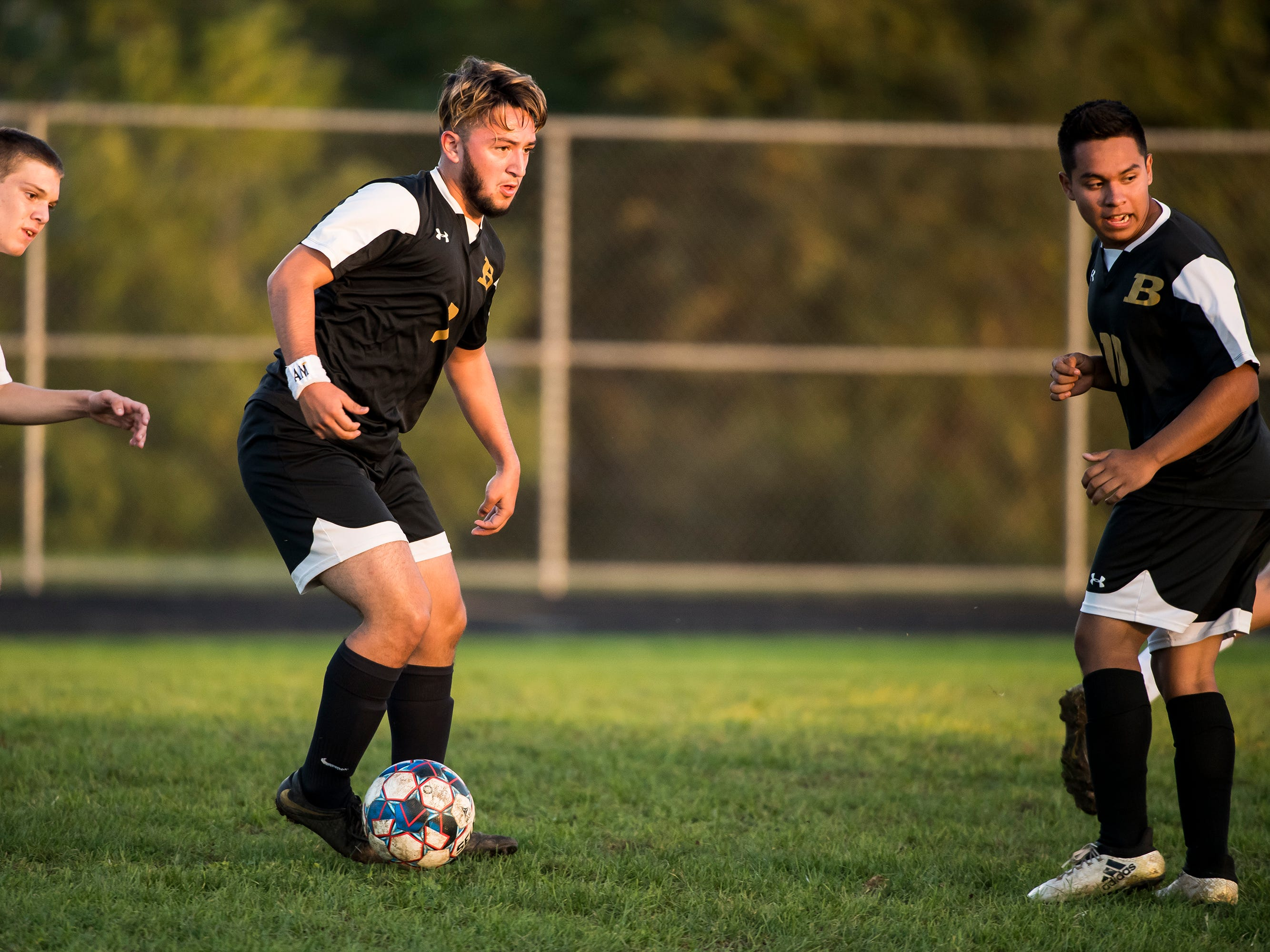 Biglerville's Esteban Alvarez Jr. looks to pass the ball during play against Delone Catholic on Wednesday, October 3, 2018. The Canners won 3-0.