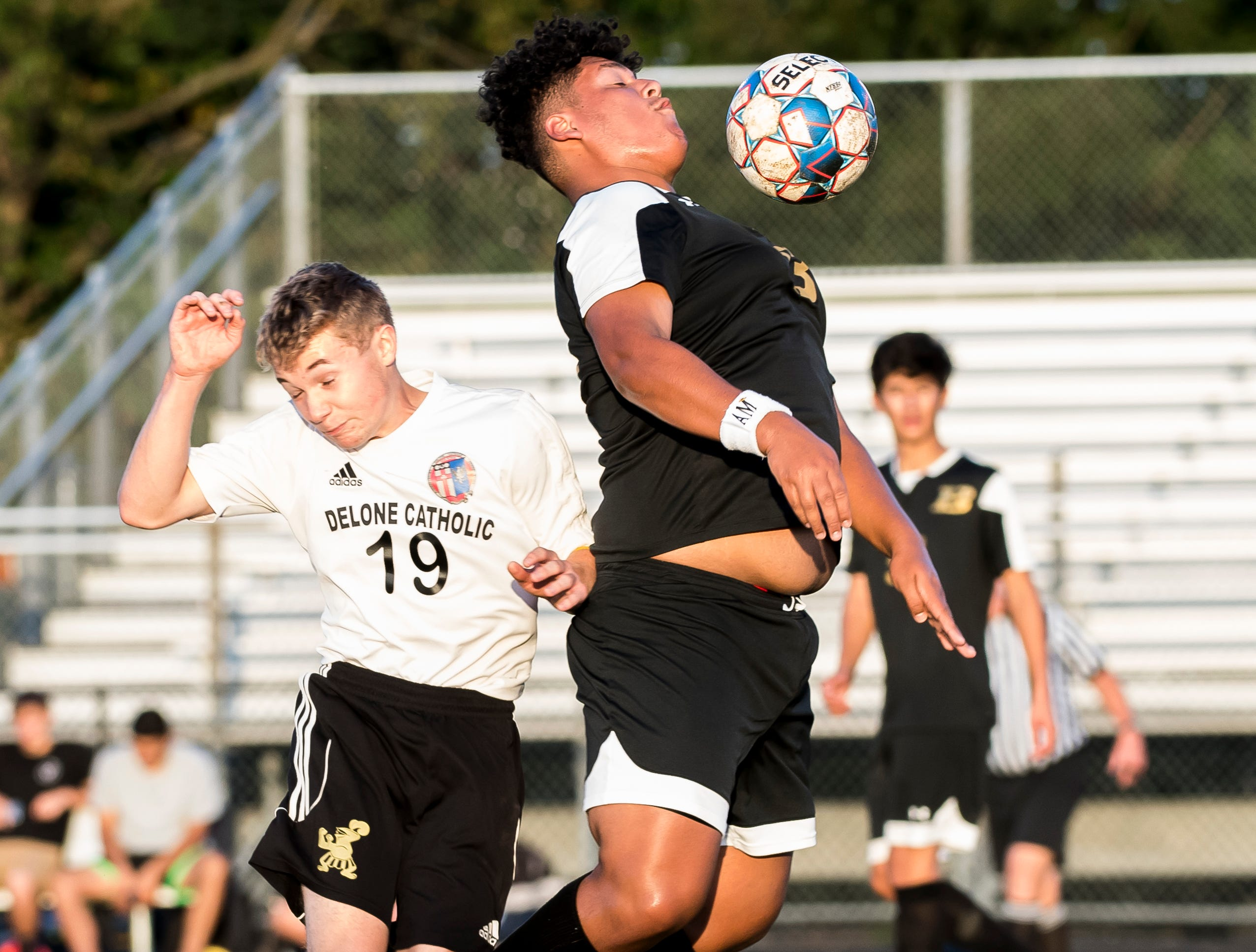 Biglerville's Michael Rayo hits the ball with his chest during play against Delone Catholic on Wednesday, October 3, 2018. The Canners won 3-0.