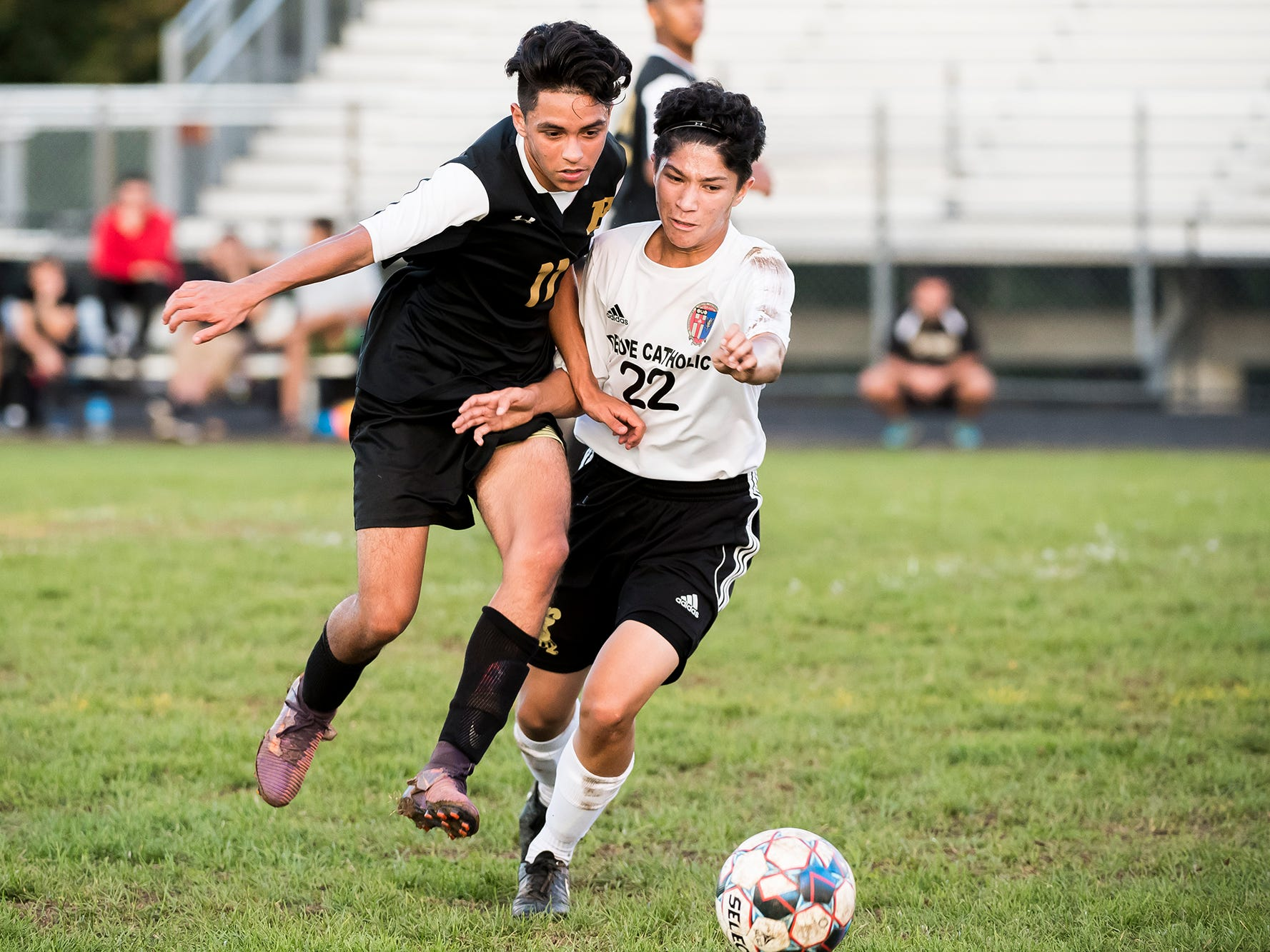 Biglerville's Christian Doreteo and Delone Catholic's Patrick O'Donnell (22) vie for the ball during a game on Wednesday, October 3, 2018. The Canners won 3-0.