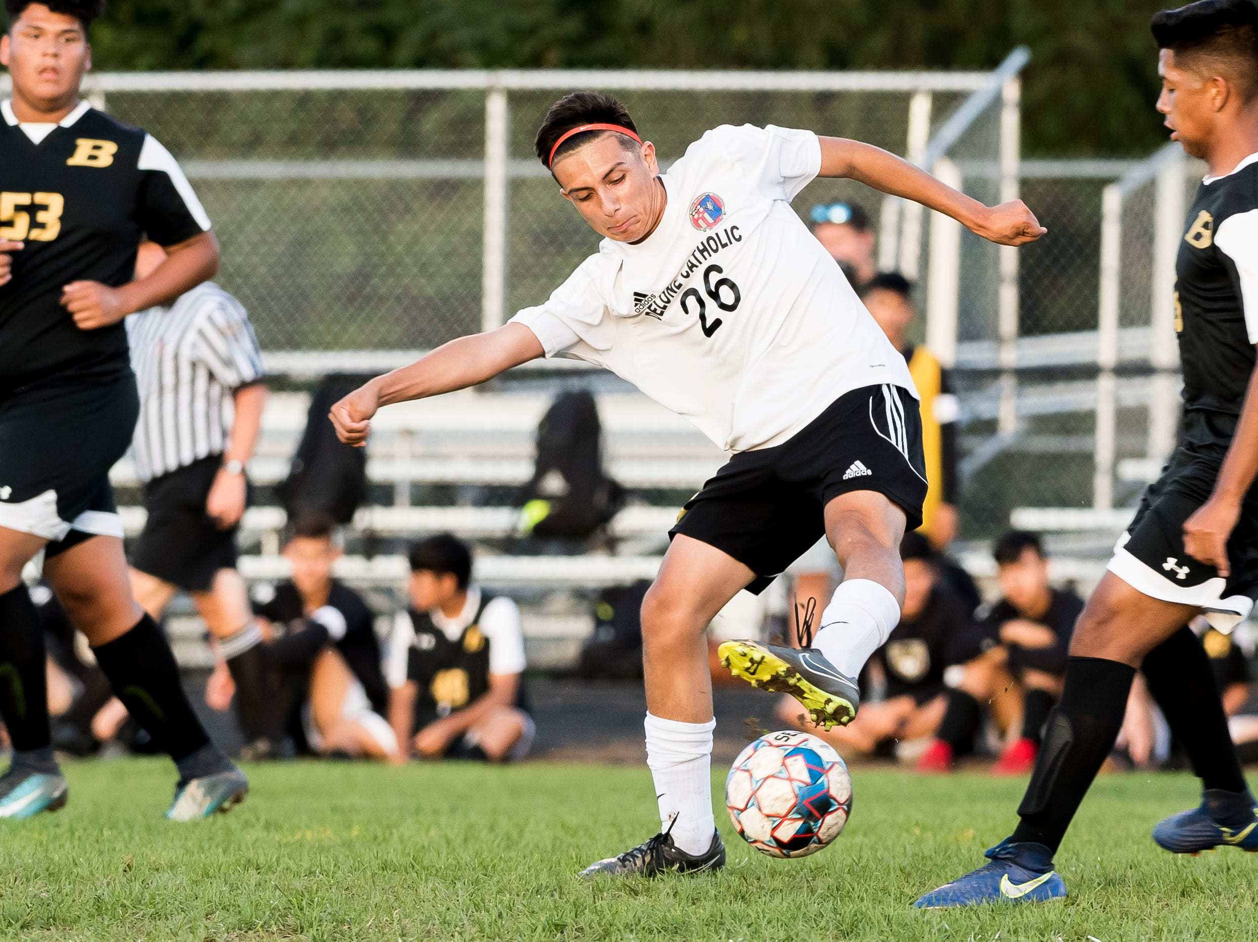 Delone Catholic's Alex Zepeda intercepts a pass intended for a Biglerville player during a game on Wednesday, October 3, 2018. The Squires fell 3-0.