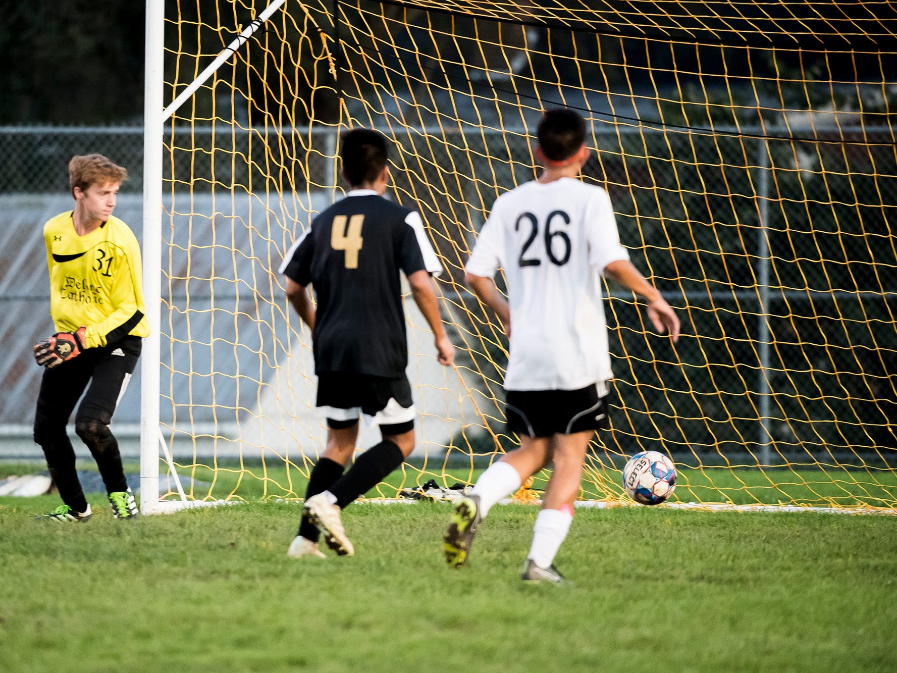 The ball rolls past Delone Catholic goalkeeper Jacob Boccabella and into the back of the net after a shot from Biglerville's Tyler Shannon on Wednesday, October 3, 2018. The Canners won 3-0.