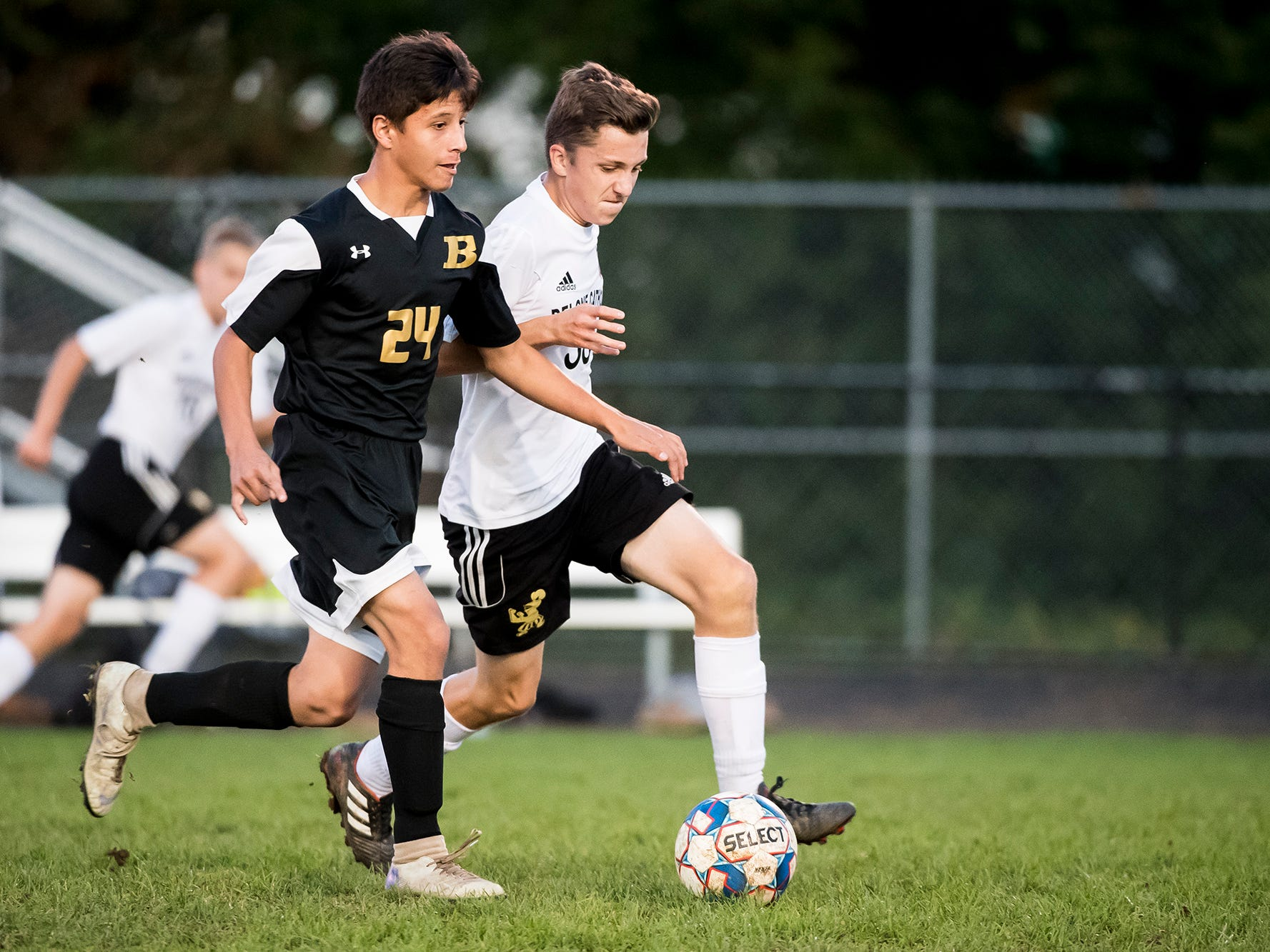 Biglervillee's Isiah Kuykendall and Delone Catholic's Owen Alster chase after the ball on Wednesday, October 3, 2018. The Canners won 3-0.
