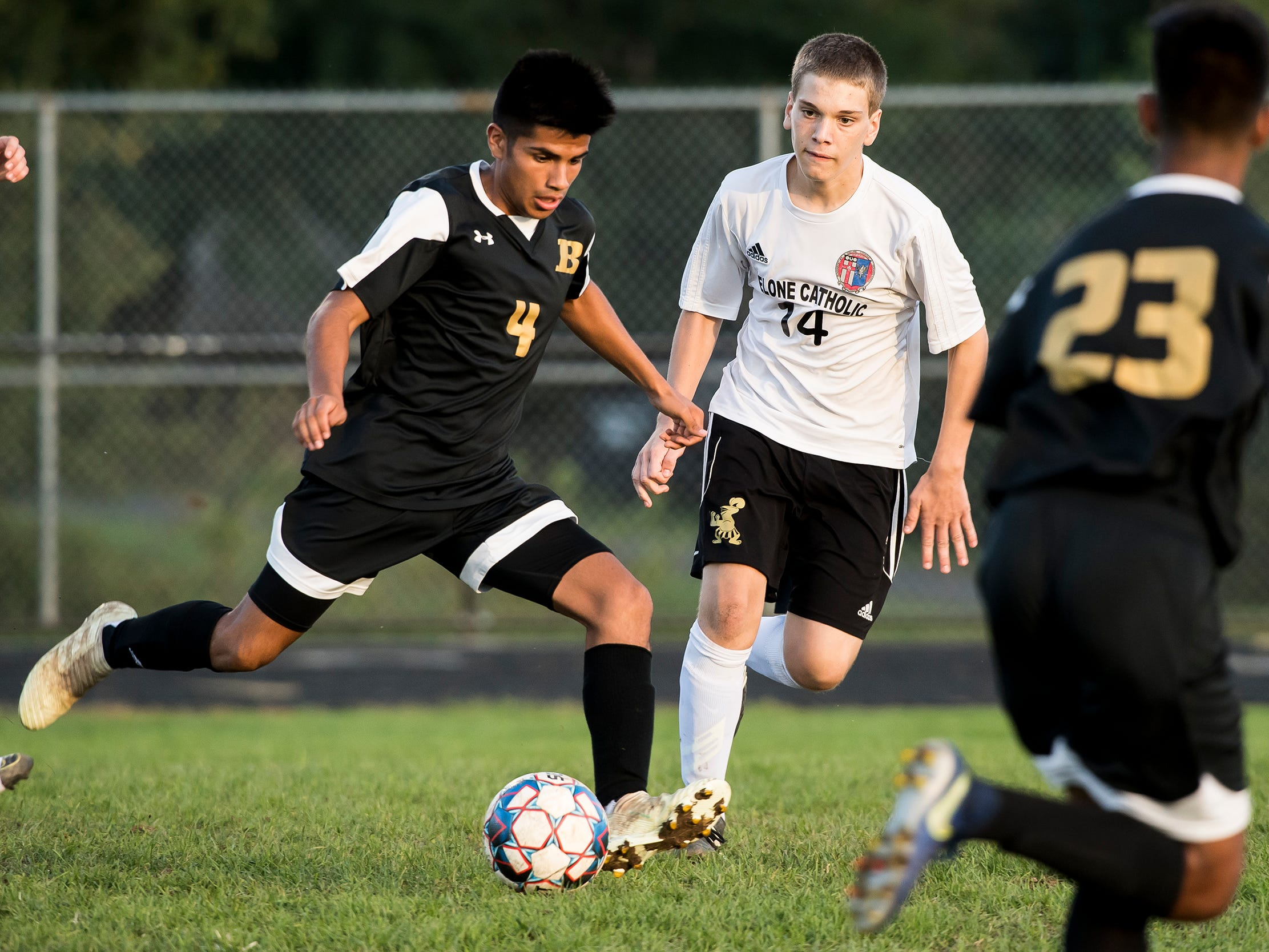 Biglerville's Lazaro Salazar Jr. (4) kicks the ball during a game against Delone Catholic on Wednesday, October 3, 2018. The Canners won 3-0.
