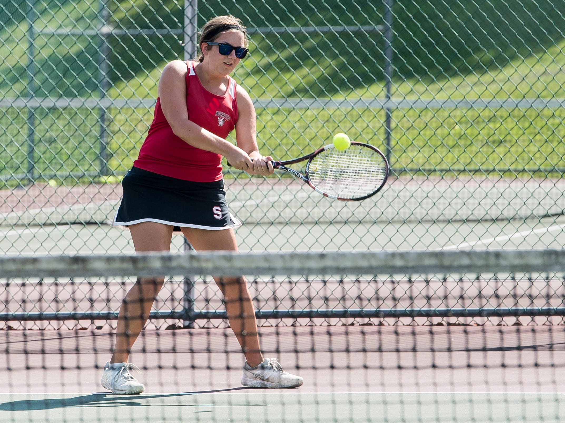 Susquehannock's Kate Cramer returns the ball to Central York's Audrey Stewart during the first round of the YAIAA 3A singles tournament on October 4, 2018. Stewart won 6-4, 6-1.