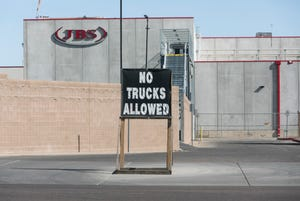 A logo sign outside of a facility occupied by JBS USA in Tolleson on Feb. 4, 2018.