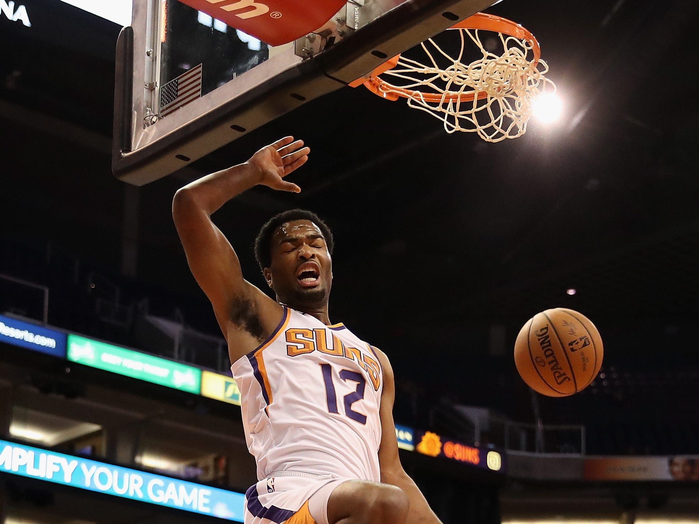 PHOENIX, AZ - OCTOBER 03:  TJ Warren #12 of the Phoenix Suns slam dunks the ball during the first half of the NBA game against the New Zealand Breakers at Talking Stick Resort Arena on October 3, 2018 in Phoenix, Arizona.  NOTE TO USER: User expressly acknowledges and agrees that, by downloading and or using this photograph, User is consenting to the terms and conditions of the Getty Images License Agreement.  (Photo by Christian Petersen/Getty Images)