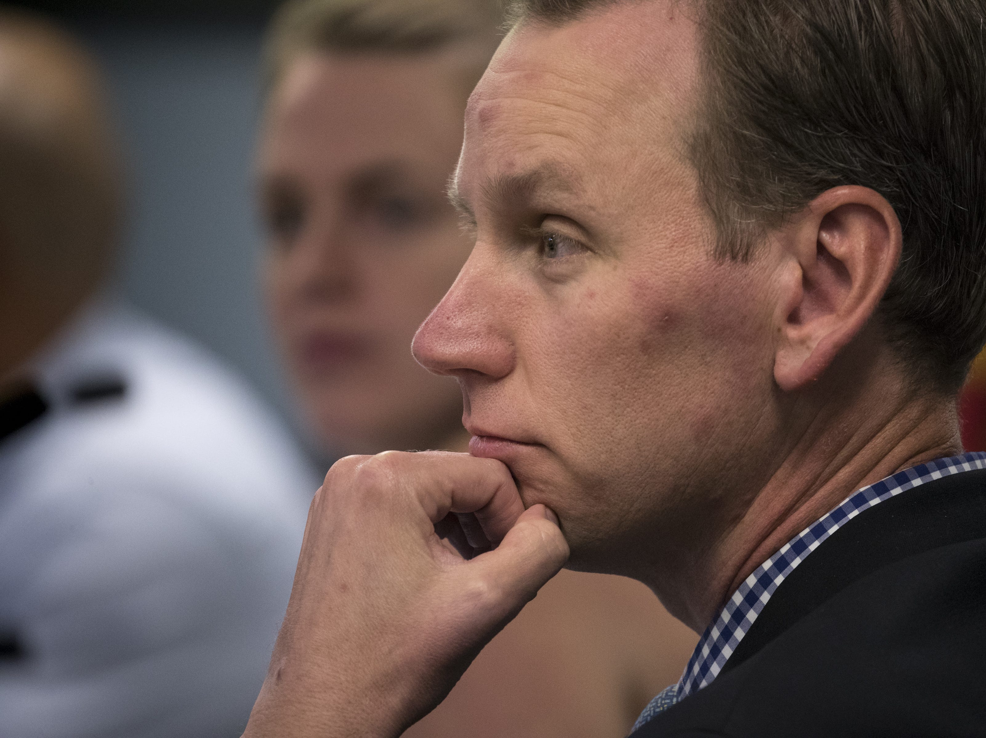 Matthew Mason, a business community member, listens during an Arizona State Board for Charter Schools meeting on Sept. 10, 2018, at the Arizona Department of Education in Phoenix.