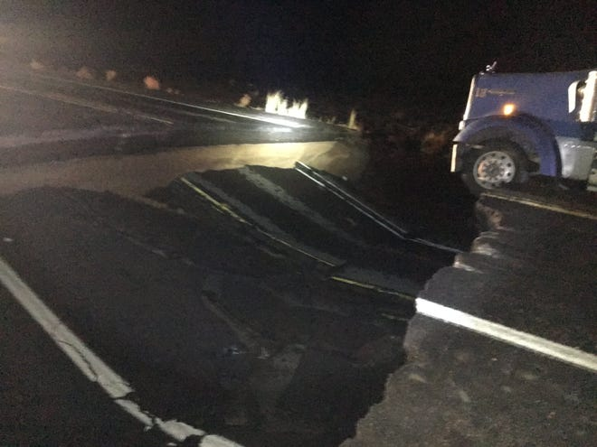 One person died in a crash after heavy rain caused a sinkhole to open up Oct. 3, 2018, on U.S. 89 near Cameron, Arizona.