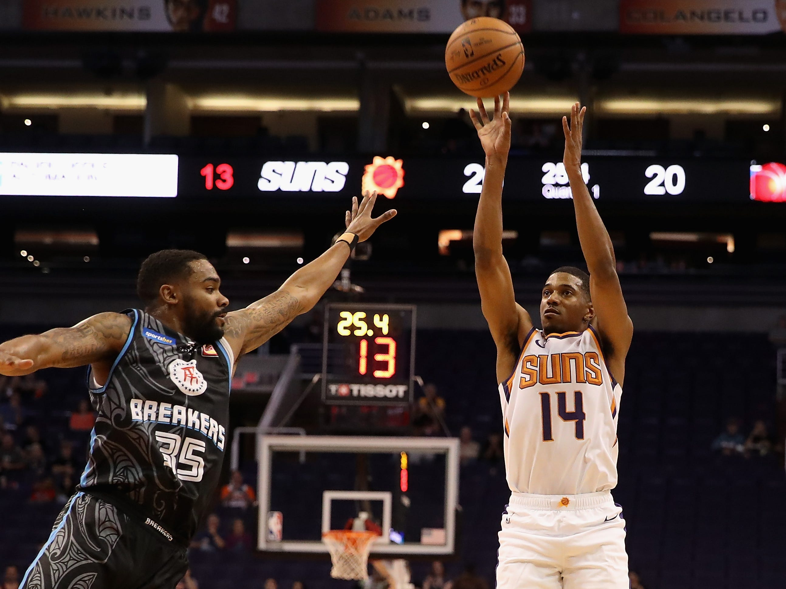 PHOENIX, AZ - OCTOBER 03:  De'Anthony Melton #14 of the Phoenix Suns attempts a shot over Patrick Richard #35 of the New Zealand Breakers during the first half of the NBA game at Talking Stick Resort Arena on October 3, 2018 in Phoenix, Arizona.  NOTE TO USER: User expressly acknowledges and agrees that, by downloading and or using this photograph, User is consenting to the terms and conditions of the Getty Images License Agreement.  (Photo by Christian Petersen/Getty Images)