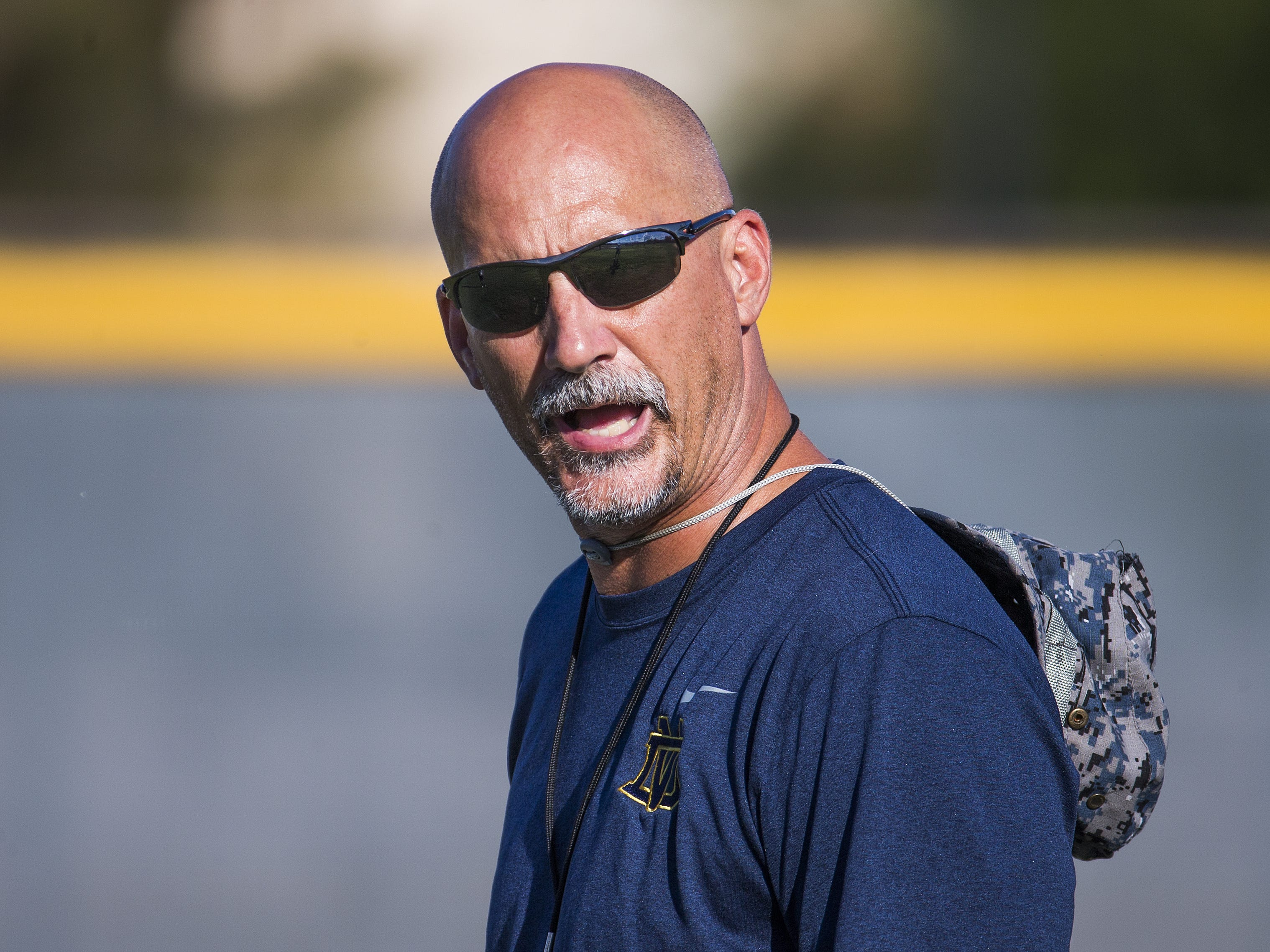 Coach Dan Hinds runs football practice at Desert Vista High School, Wednesday, October 3, 2018.
