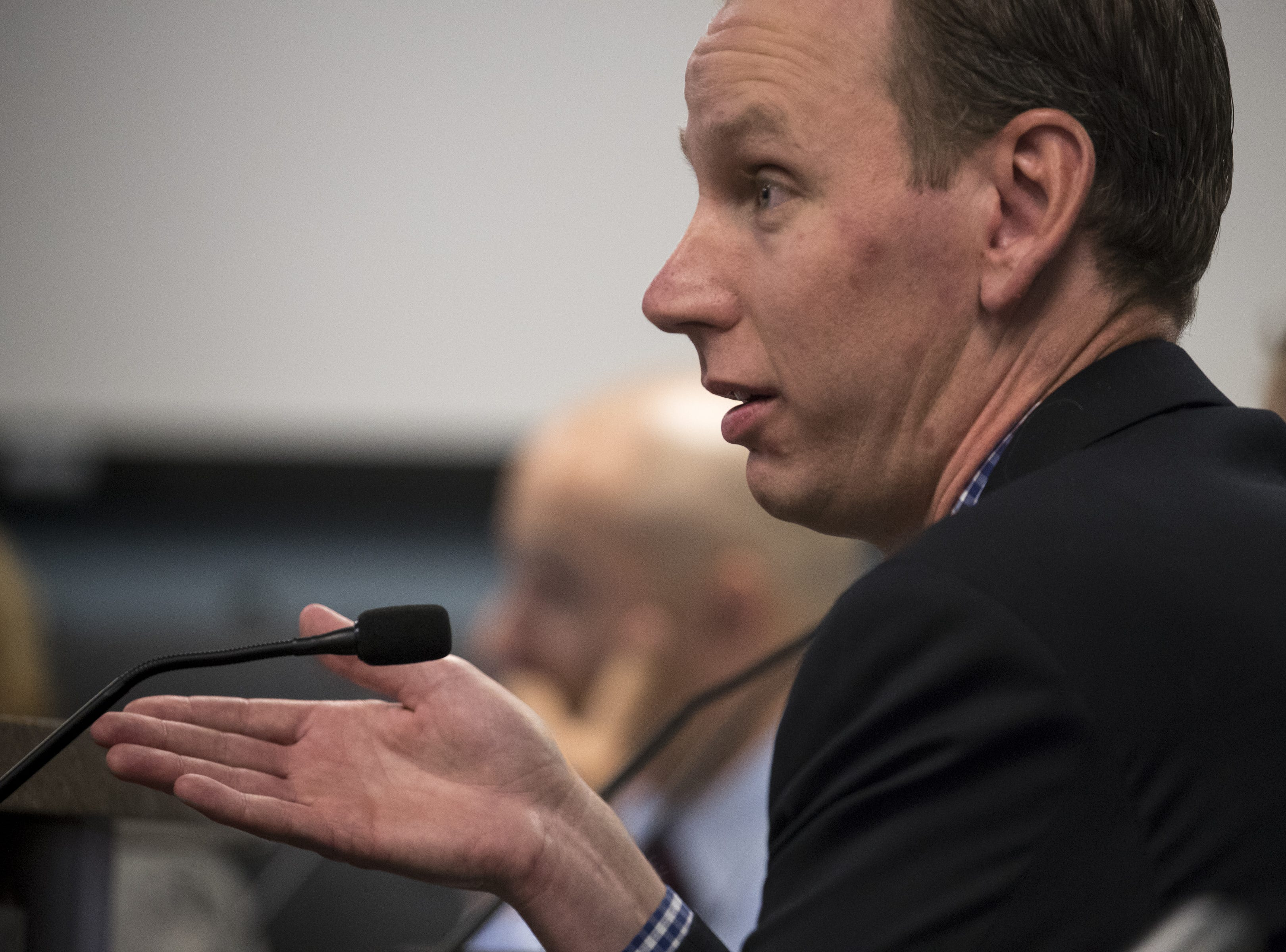 Matthew Mason, a business community member, asks a question during an Arizona State Board for Charter Schools meeting on Sept. 10, 2018, at the Arizona Department of Education in Phoenix.