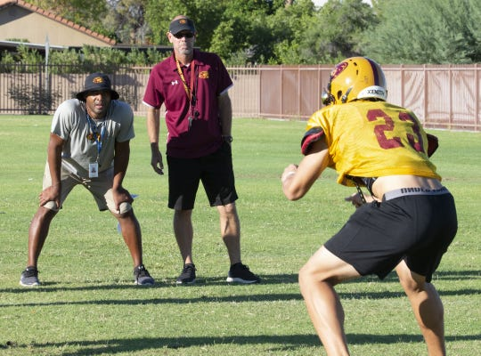 Mountain Pointe's defensive coordinator Conrad Hamilton, left, and head coach Rich Wellbrock watches a drill during practice in Phoenix on October 3, 2018.