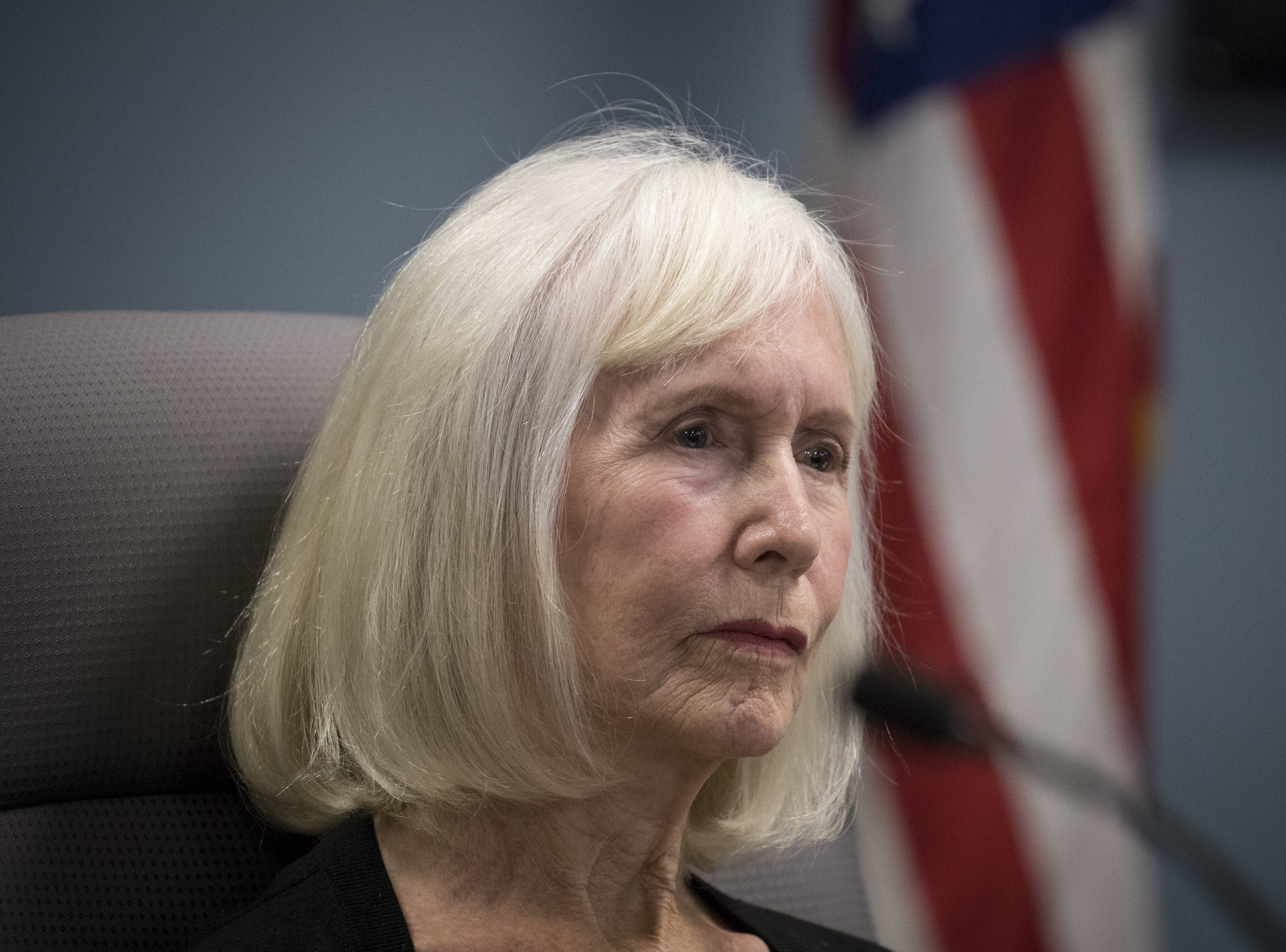 Carol Crockett, a public member, listens during an Arizona State Board for Charter Schools meeting on Sept. 10, 2018, at the Arizona Department of Education in Phoenix.