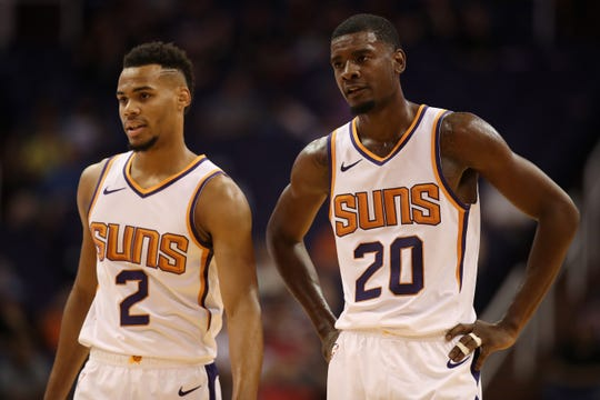 PHOENIX, AZ - OCTOBER 03:  (R-L) Josh Jackson #20 and Elie Okobo #2 of the Phoenix Suns stand on the court during the first half of the NBA game against the New Zealand Breakers at Talking Stick Resort Arena on October 3, 2018 in Phoenix, Arizona.  NOTE TO USER: User expressly acknowledges and agrees that, by downloading and or using this photograph, User is consenting to the terms and conditions of the Getty Images License Agreement.  (Photo by Christian Petersen/Getty Images)