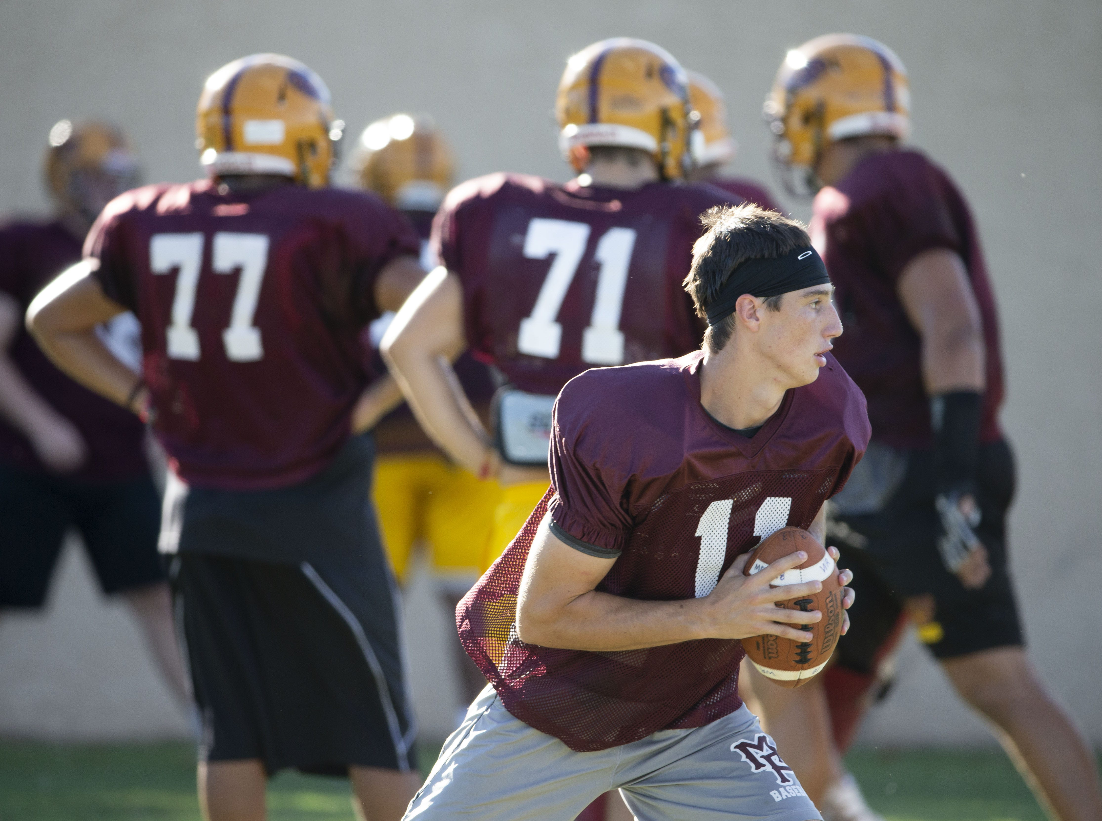 Mountain Pointe's quarterback Nick Wallerstedt runs a drill during practice in Phoenix on October 3, 2018.