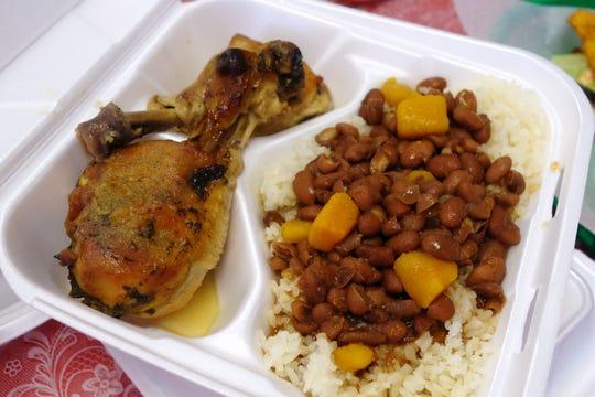 Arroz blanco con habichuelas y muslos de pollo al horno (roast chicken with white rice and beans) at Millie's Cafe in Mesa.