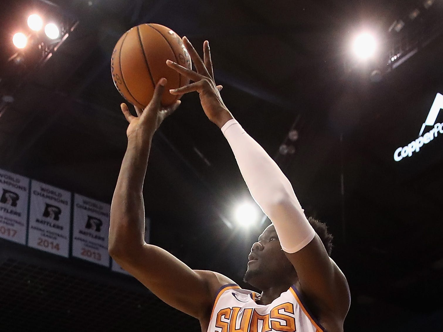 PHOENIX, AZ - OCTOBER 03:  Deandre Ayton #22 of the Phoenix Suns attempts a shot during the first half of the NBA game against the New Zealand Breakers at Talking Stick Resort Arena on October 3, 2018 in Phoenix, Arizona.  NOTE TO USER: User expressly acknowledges and agrees that, by downloading and or using this photograph, User is consenting to the terms and conditions of the Getty Images License Agreement.  (Photo by Christian Petersen/Getty Images)