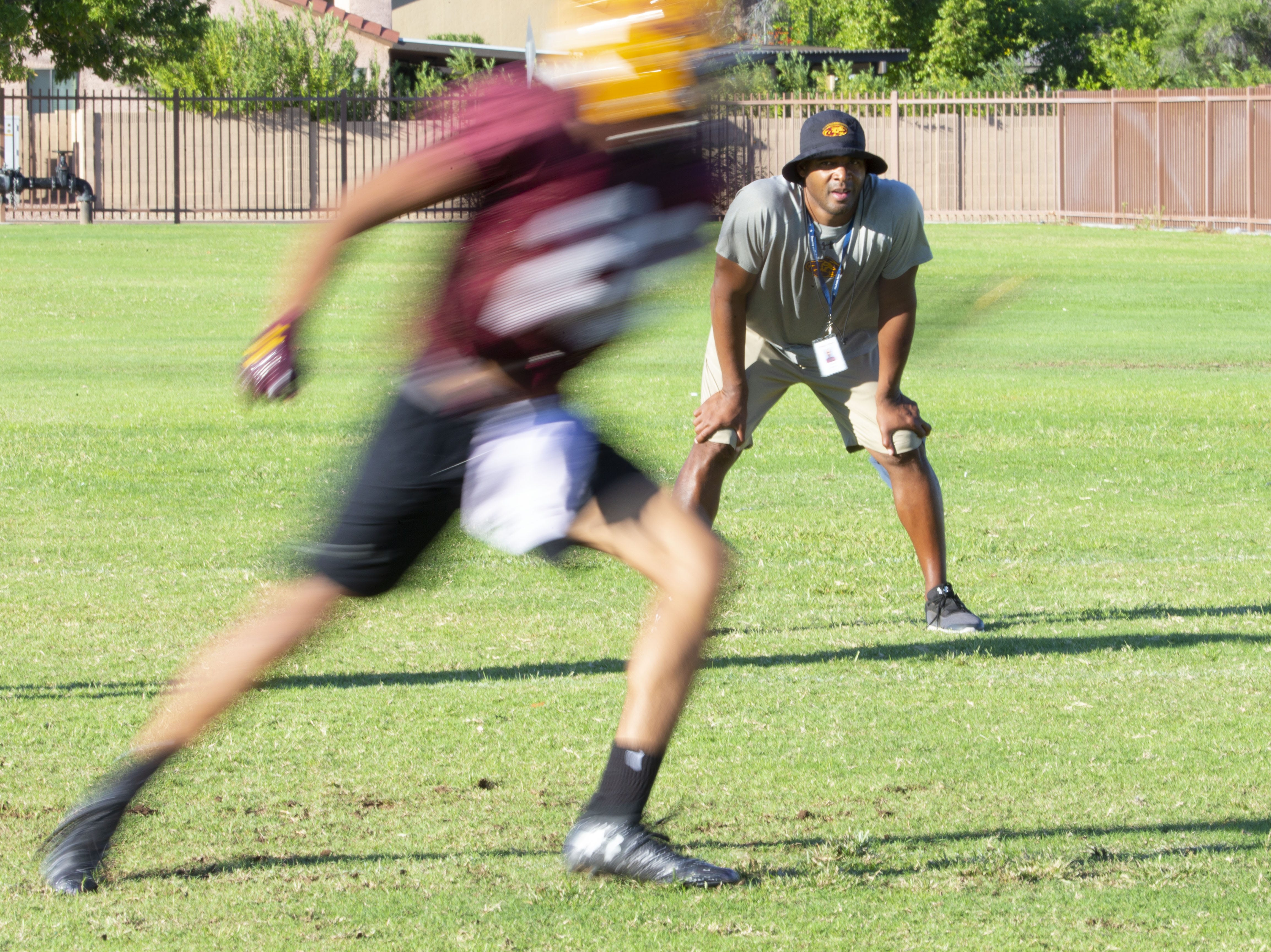 Mountain Pointe's defensive coordinator Conrad Hamilton watches drills during practice in Phoenix on October 3, 2018.