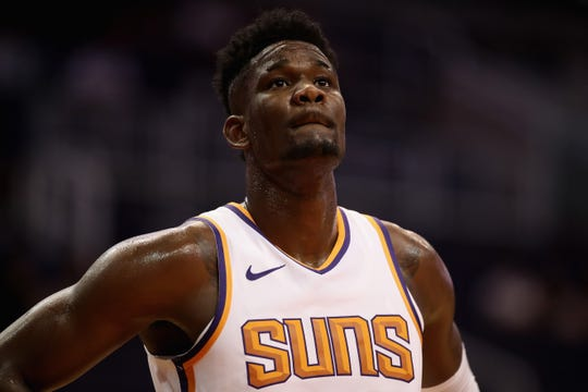 Suns rookie center Deandre Ayton stands on the court during the first half of a game against the New Zealand Breakers on Wednesday at Talking Stick Resort Arena.