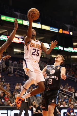 PHOENIX, AZ - OCTOBER 03:  Mikal Bridges #25 of the Phoenix Suns lays up a shot past Finn Delany #3 of the New Zealand Breakers during the first half of the NBA game at Talking Stick Resort Arena on October 3, 2018 in Phoenix, Arizona.  NOTE TO USER: User expressly acknowledges and agrees that, by downloading and or using this photograph, User is consenting to the terms and conditions of the Getty Images License Agreement.  (Photo by Christian Petersen/Getty Images)