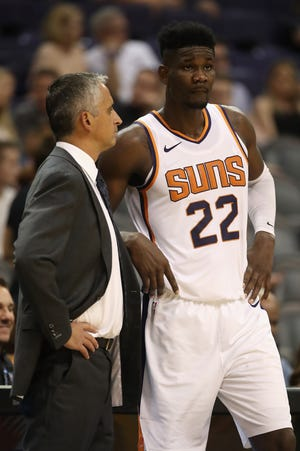 PHOENIX, AZ - OCTOBER 03:  Head coach Igor Kokoskov of the Phoenix Suns talks with Deandre Ayton #22 during the first half of the NBA game against the New Zealand Breakers at Talking Stick Resort Arena on October 3, 2018 in Phoenix, Arizona.  NOTE TO USER: User expressly acknowledges and agrees that, by downloading and or using this photograph, User is consenting to the terms and conditions of the Getty Images License Agreement.  (Photo by Christian Petersen/Getty Images)