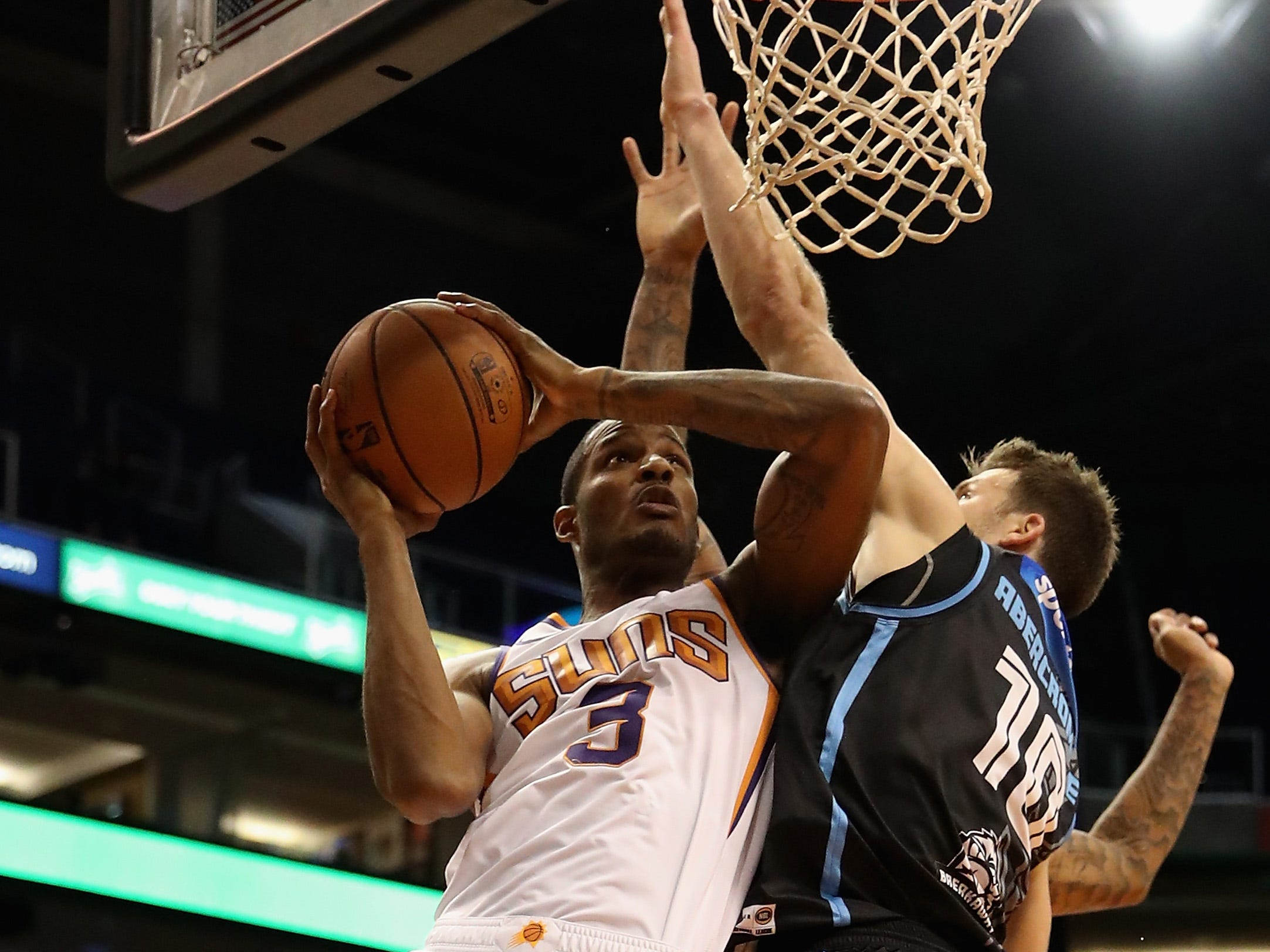 PHOENIX, AZ - OCTOBER 03:  Trevor Ariza #3 of the Phoenix Suns drives to the basket against against Thomas Abercromnbie #10 of the New Zealand Breakers during the first half of the NBA game at Talking Stick Resort Arena on October 3, 2018 in Phoenix, Arizona.  NOTE TO USER: User expressly acknowledges and agrees that, by downloading and or using this photograph, User is consenting to the terms and conditions of the Getty Images License Agreement.  (Photo by Christian Petersen/Getty Images)
