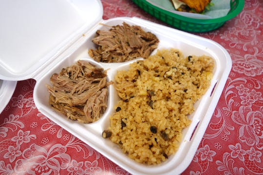 Arroz con gandules y cerdo al horno (rice with pigeon peas and roasted pork) at Millie's Cafe in Mesa.
