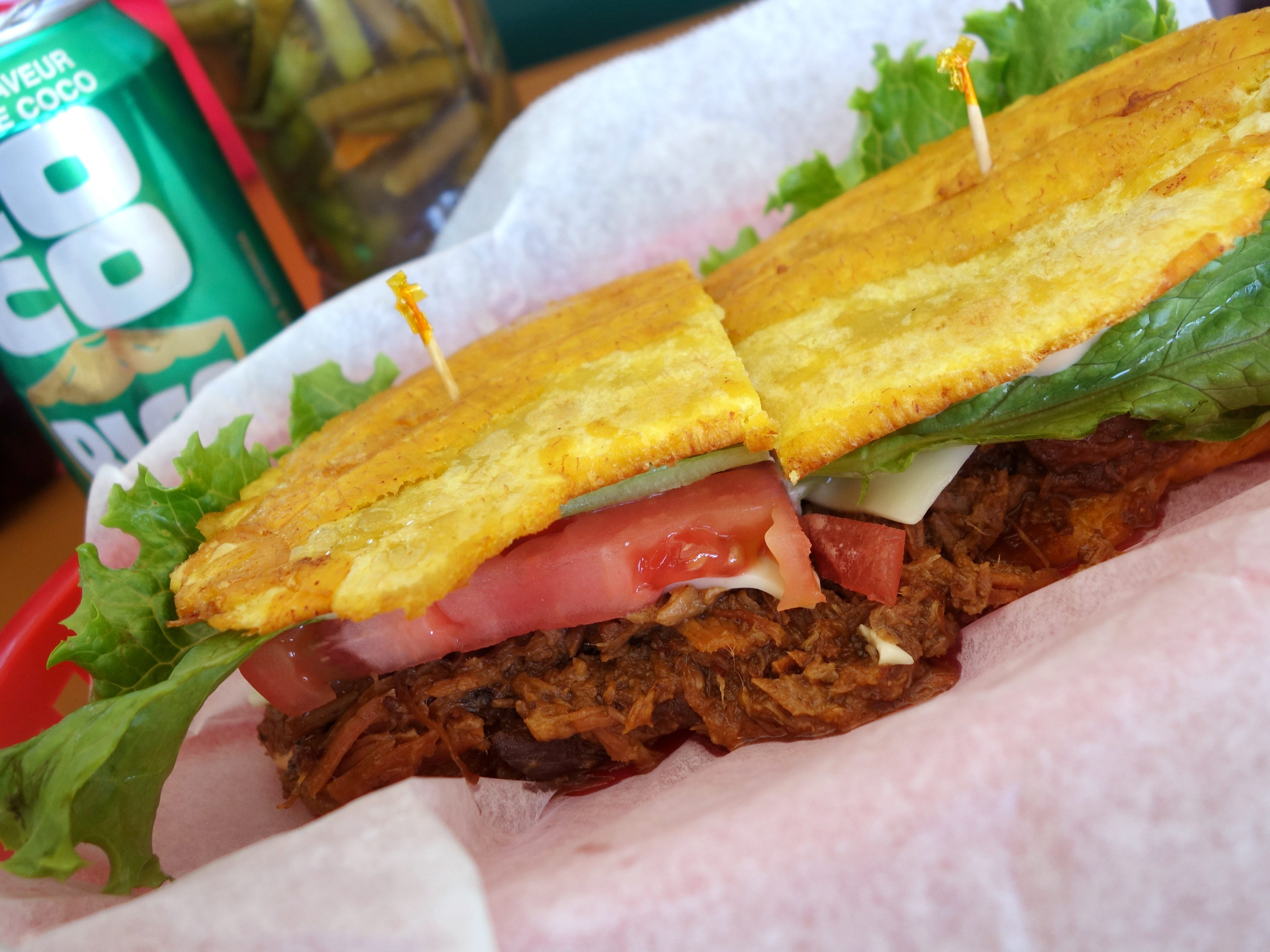 Jibarito with roasted pork, cheese, lettuce, tomato, mayonnaise and fried plantains at Millie's Cafe in Mesa.
