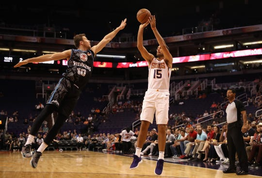PHOENIX, AZ - OCTOBER 03:  Ryan Anderson #15 of the Phoenix Suns attempts a shot over Thomas Abercromnbie #10 of the New Zealand Breakers during the first half of the NBA game at Talking Stick Resort Arena on October 3, 2018 in Phoenix, Arizona.  NOTE TO USER: User expressly acknowledges and agrees that, by downloading and or using this photograph, User is consenting to the terms and conditions of the Getty Images License Agreement.  (Photo by Christian Petersen/Getty Images)