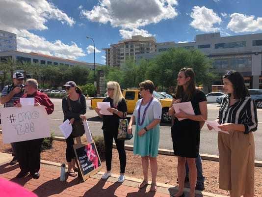 Protesters gather at Flake's office