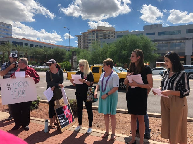 Protesters gathered outside Sen. Jeff Flake's office in Phoenix on Thursday to seek a no vote for Brett Kavanaugh's nomination to the Supreme Court.