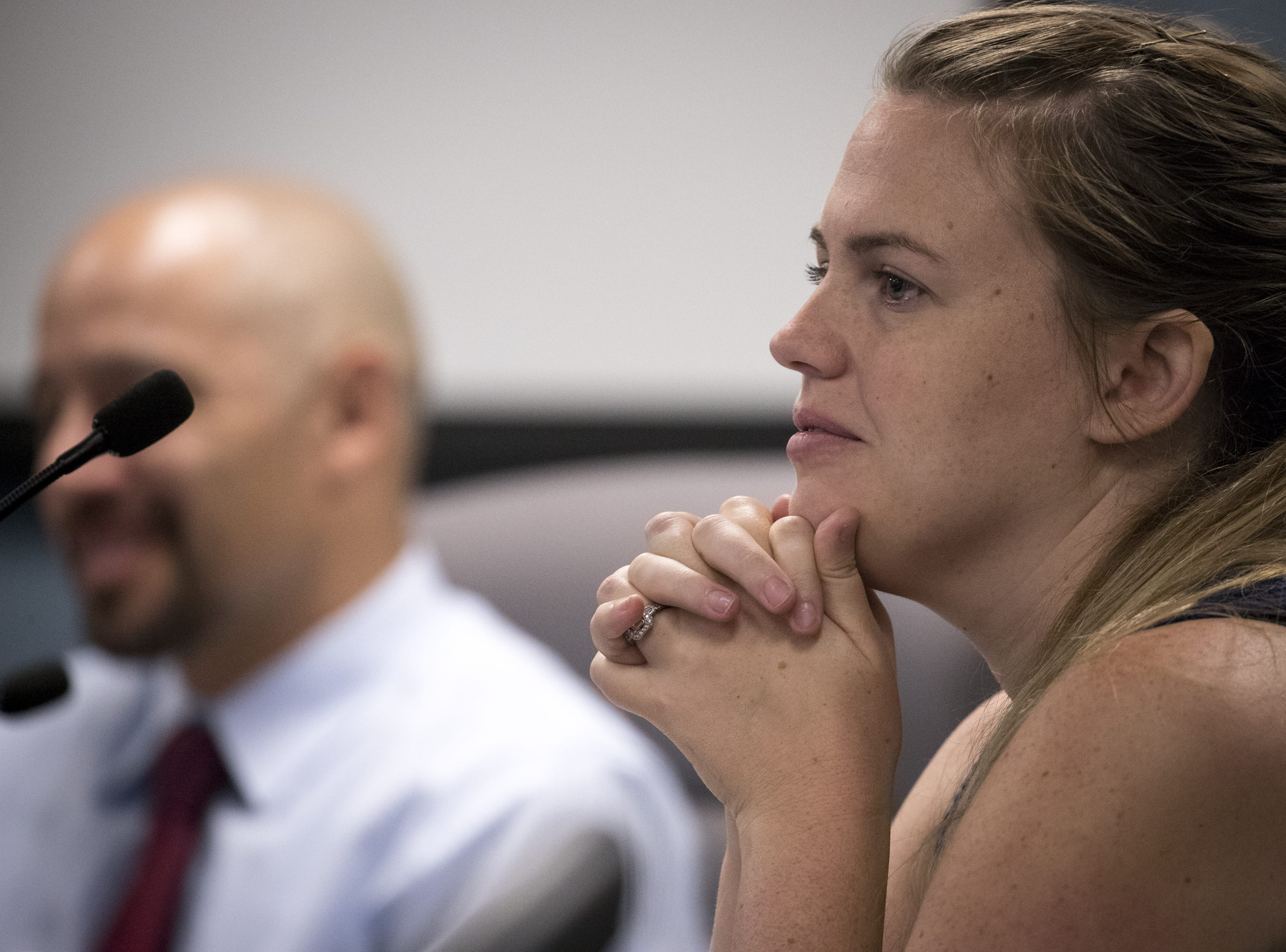 Mary Ellen Lee, a charter school teacher, listens during an Arizona State Board for Charter Schools meeting on Sept. 10, 2018, at the Arizona Department of Education in Phoenix.