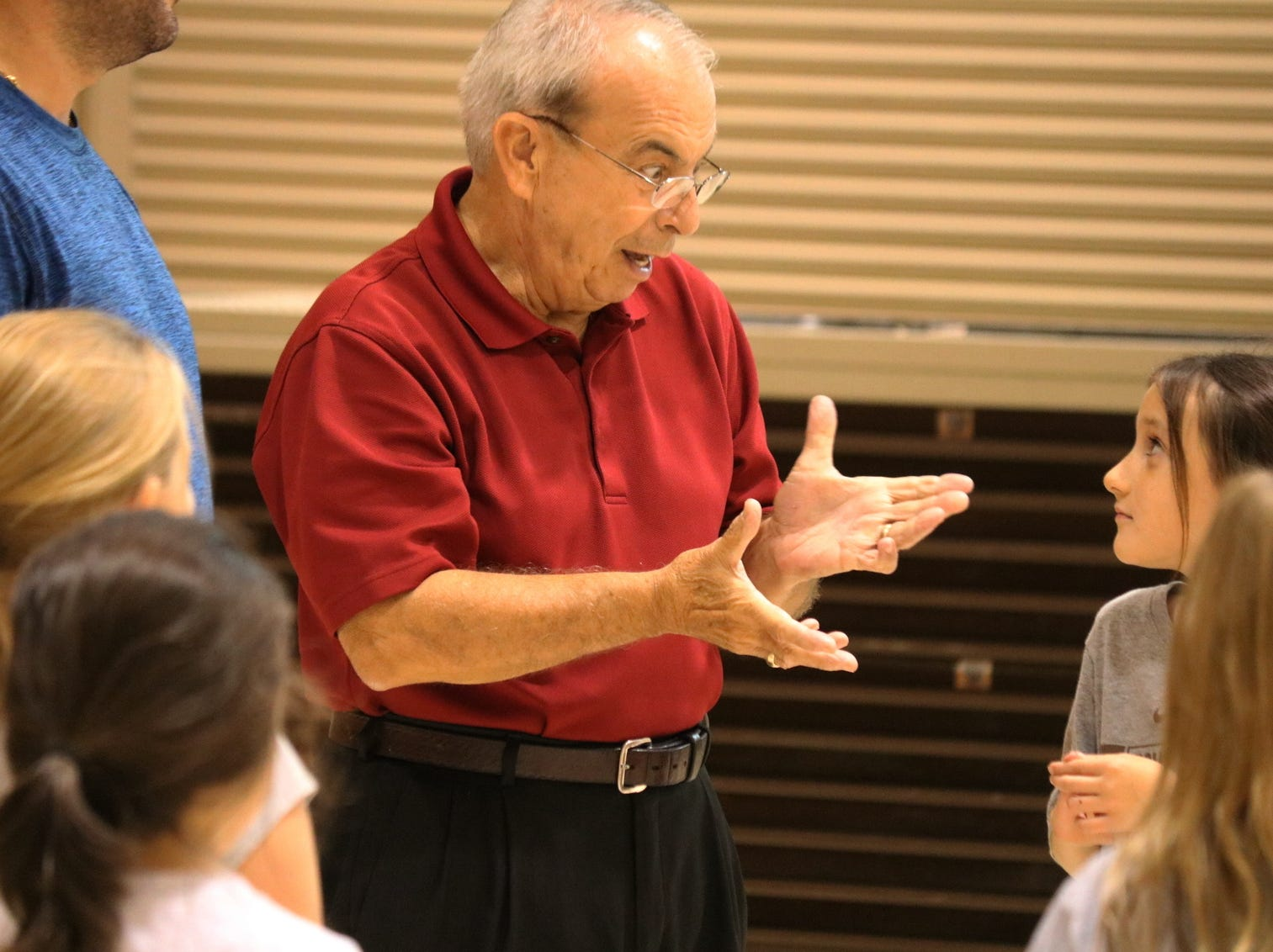 Retired music teacher Greg Fox, of Port Clinton, began teaching Immaculate Conception Students square dancing on Wednesday so they can show what they learned at the Buckles Pig Roast and Square Dance on Oct. 20.