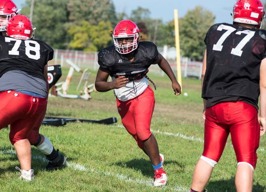 Port Huron High School tight end Malik Davis runs during a practice drill Wednesday, Oct. 3, 2018 during football practice at the high school.