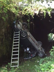 Kingston Police said a 90-year-old man hit a stopped car at the intersection of Delaware and Hasbrouck avenues, pushing the car over the edge and onto an old train rail track.