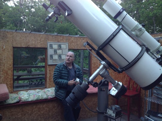 Bob Berman tests a slow-motion control on his observatory's star-tracking mount, which holds a research grade 12.6 inch reflector and a Takahashi 5 inch refractor.