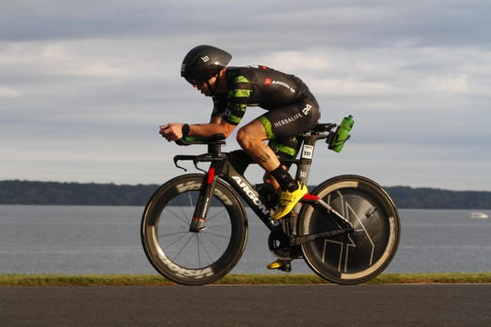 Joe Klinedinst, a Dallastown alumnus and teacher, rides the bike during that portion of an Ironman competition last weekend in Cambridge, Maryland. Klinedinst finished fifth overall and qualified for the world competition in Kona, Hawaii, next year.