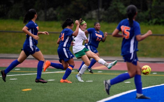 York Catholic's Sydney Mentzer kicks a goal while surrounded by York High defenders, Thursday, Oct. 4, 2018. John A. Pavoncello photo