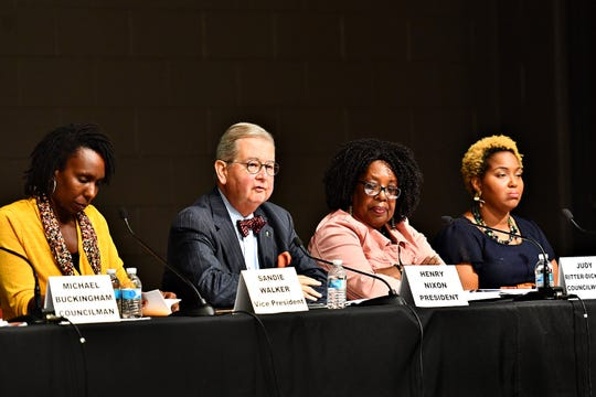 York City Council members, from left, Vice President Sandie Walker, President Henry Nixon, Judy Ritter-Dixon and Edquina Washington take the stage during a York City Council Town Hall Meeting at Logos Academy in York City, Wednesday, Oct. 3, 2018. Dawn J. Sagert photo
