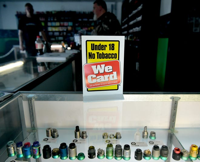 Signs warning underage buyers are posted at Life Smoke Vapors in Springettsbury Township Thursday, Oct. 4, 2018. It's illegal for anyone under the age of 18 to purchase vapes in Pennsylvania. Bill Kalina photo