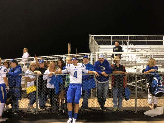 Reed quarterback Baylor Horning with his family.