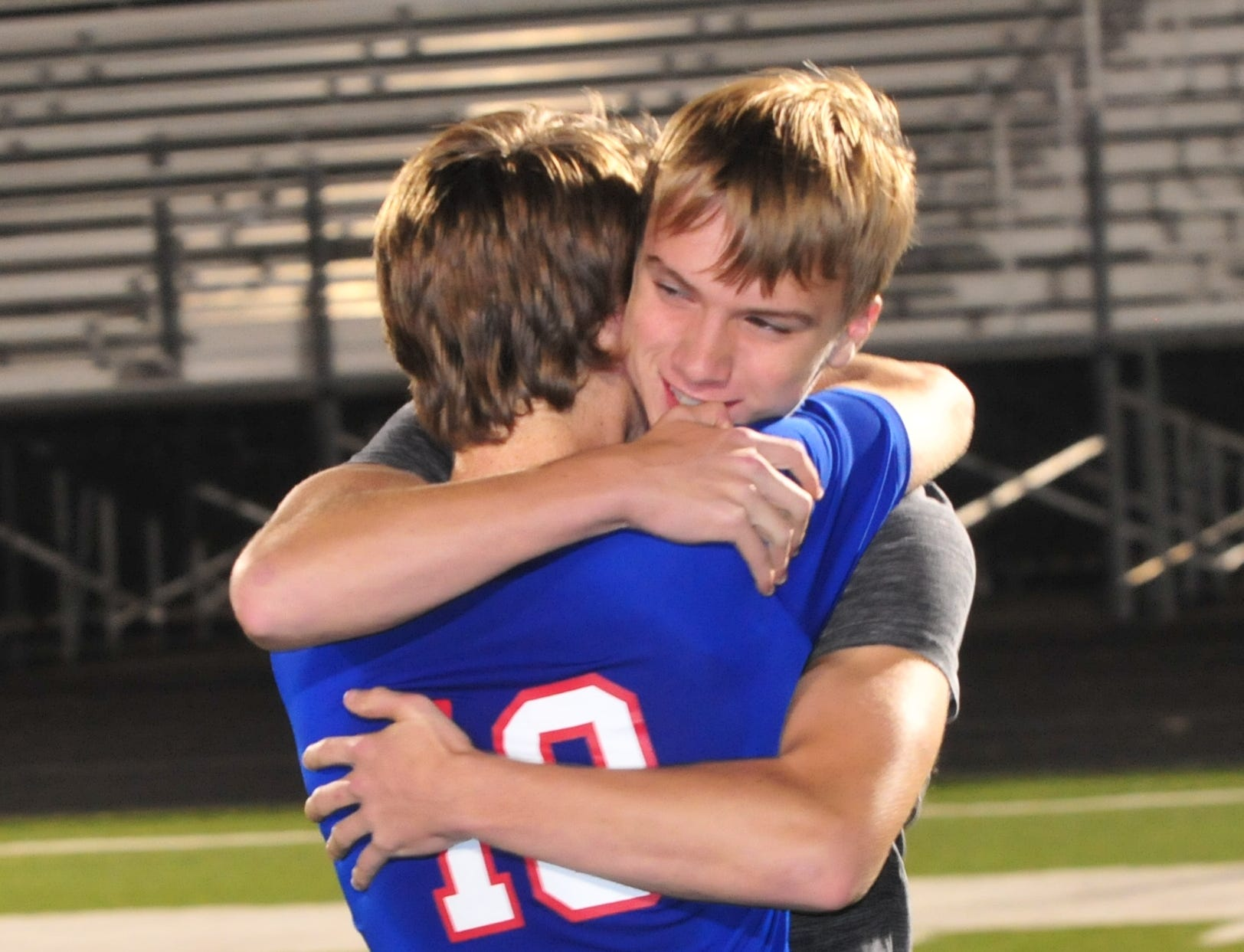 Union County's Cam Sanford is hugged after a 6-1 loss to Seton Catholic during the IHSAA Class A Sectional 42 boys soccer semifinal at Knightstown Wednesday, Oct. 3, 2018.
