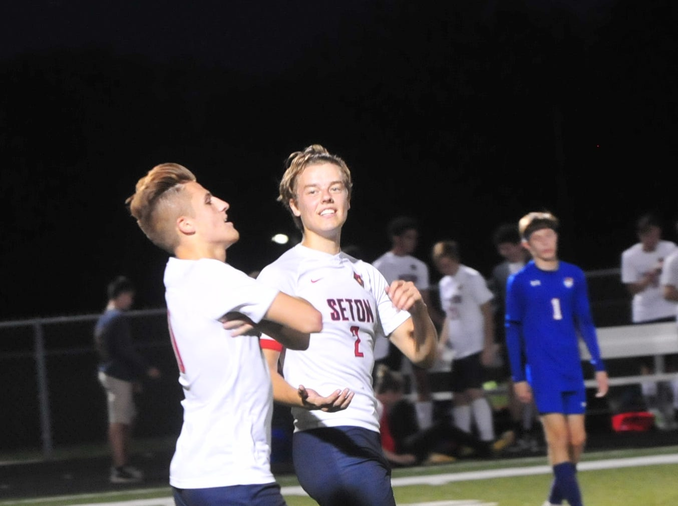 Sam Brenneke, left, and Adam Deitsch of Seton Catholic celebrate a goal from Brenneke during the IHSAA Class A Sectional 42 boys soccer semifinal at Knightstown Wednesday, Oct. 3, 2018.