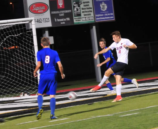 Sam Brenneke of Seton Catholic (10) kicks the ball during the IHSAA Class A Sectional 42 boys soccer semifinal against Union County at Knightstown Wednesday, Oct. 3, 2018.