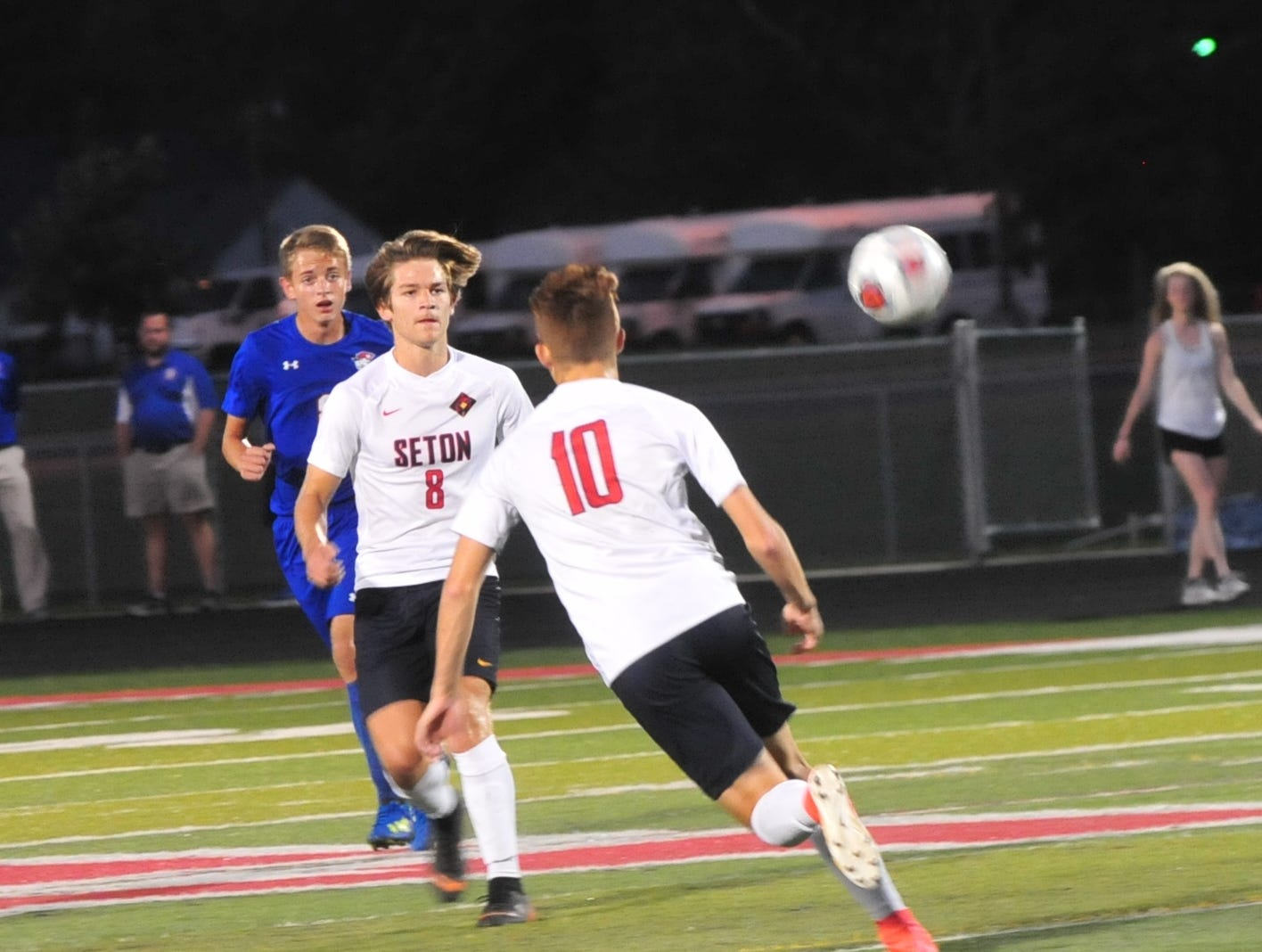 Nick Berger (8) and Sam Brenneke (10) of Seton Catholic move the ball during the IHSAA Class A Sectional 42 boys soccer semifinal against Union County at Knightstown Wednesday, Oct. 3, 2018.
