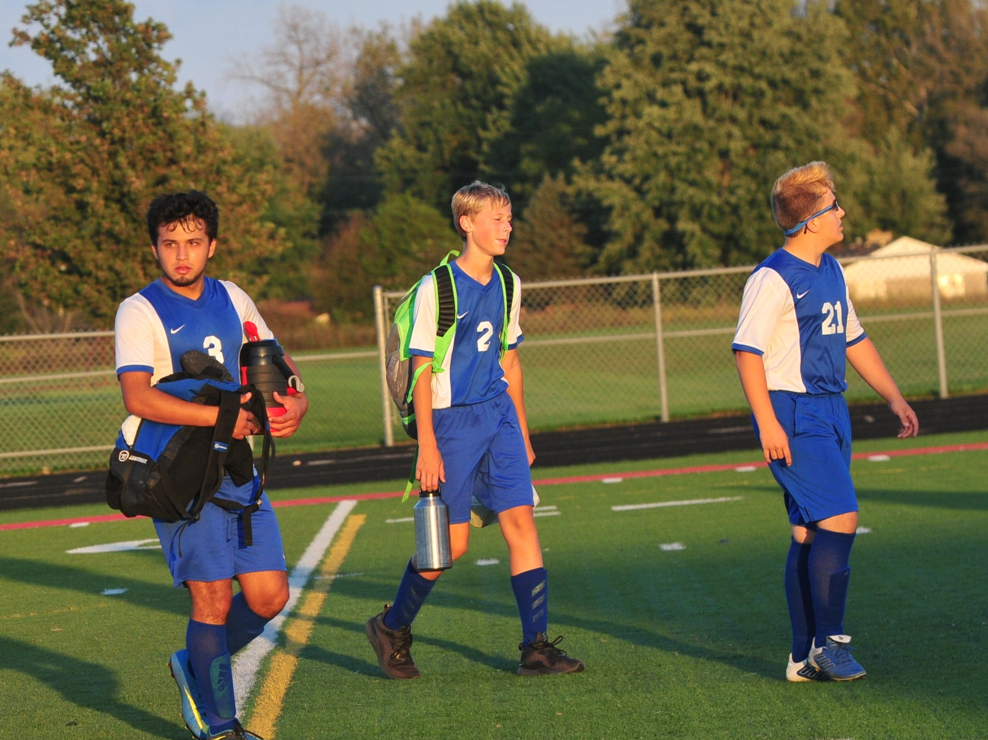 Centerville's Dante Torres (3), Lewis Marshall (2) and Cedric Jenkins (21) walk off the field after a 3-2 win during the IHSAA Class A Sectional 42 boys soccer semifinal at Knightstown Wednesday, Oct. 3, 2018.