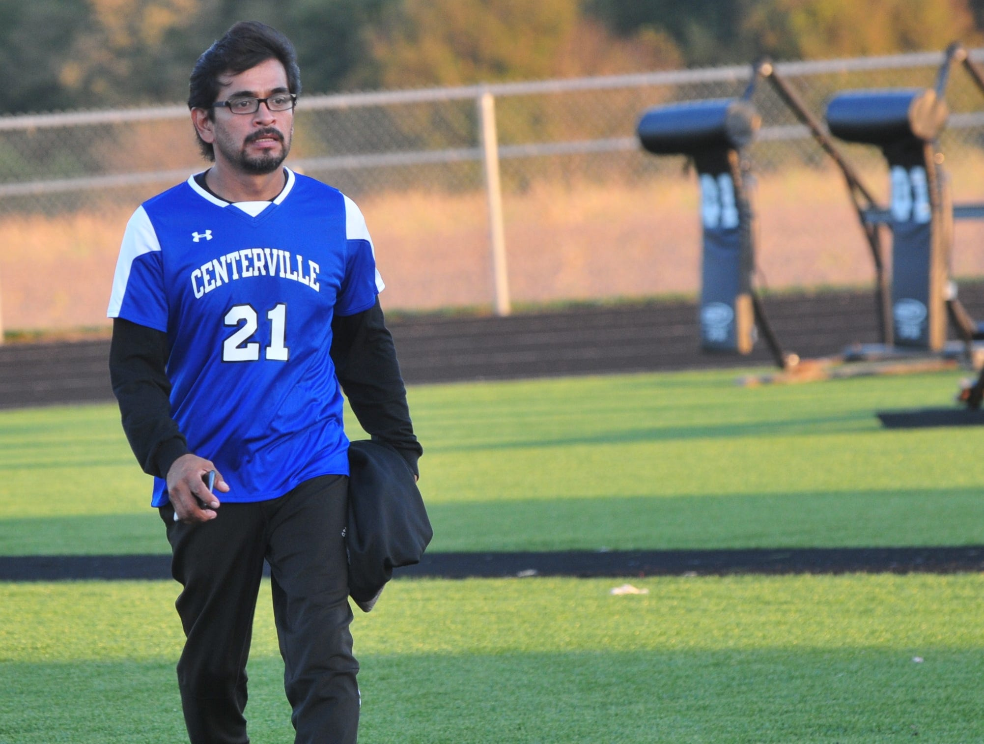 Centerville High School boys soccer coach Ricardo Torres walks off the field after a 3-2 win during the IHSAA Class A Sectional 42 boys soccer semifinal at Knightstown Wednesday, Oct. 3, 2018.